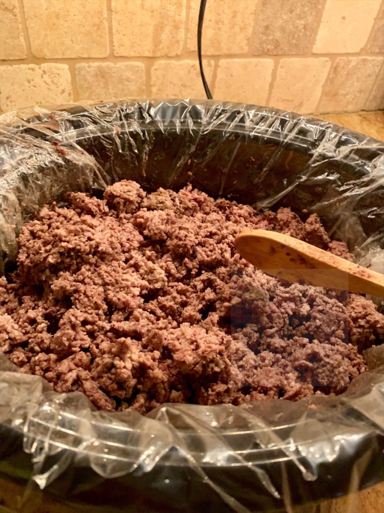 ground beef browning in slow cooker