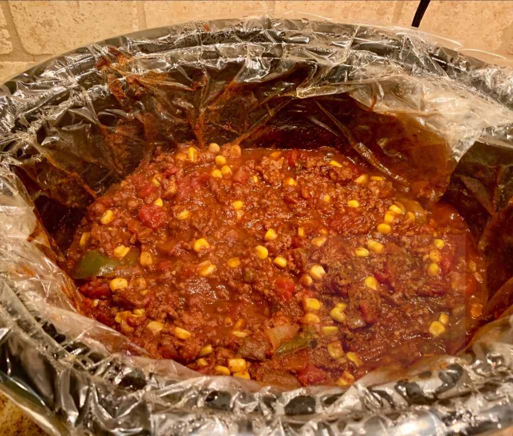 top down view of chili in slow cooker