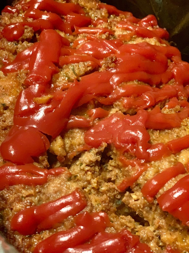 close up of meatloaf with ketchup on top
