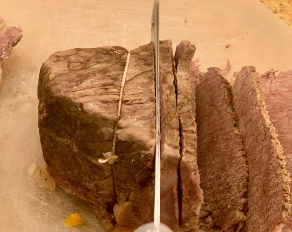 easy roast  being sliced with an electric knife