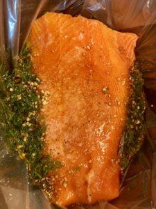 Salmon fillet with all seasonings spooned overtop