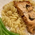 Salmon on plate with pasta and green beans