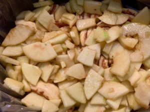 Apple mixture on top Of cinnamon rolls