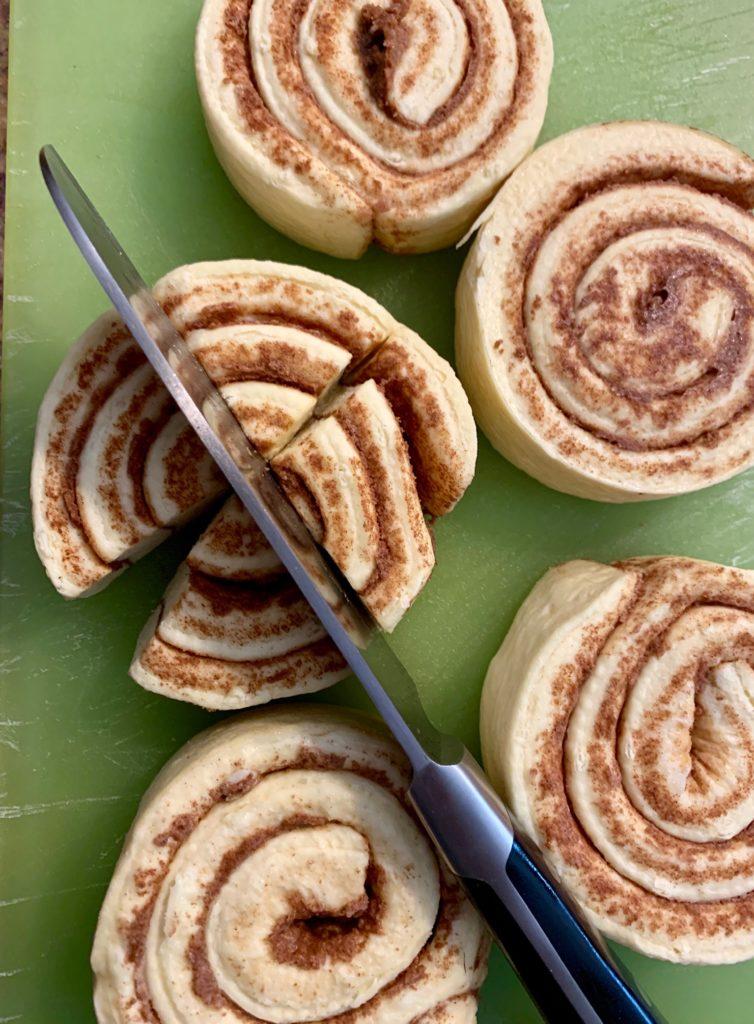 Cutting cinnamon rolls in quarters