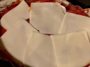 Mozzerella slices being used as topping