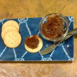 Apple butter on a tray with crackers