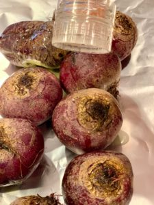 raw beets being salted.by a salt grinder