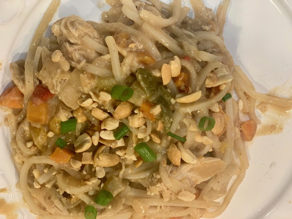 finished dish of lazy soy-peanut chicken on a white place