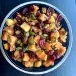 looking down on a bowl of cranberry and pumpkin seed stuffing ready to be served