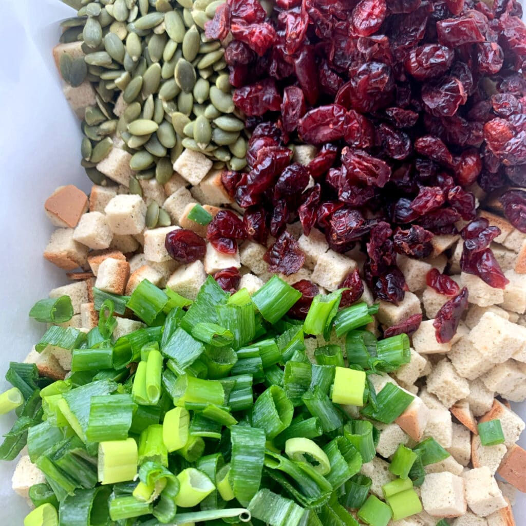 cranberries, pumpkin seeds, herbed bread cubes, sliced green onions