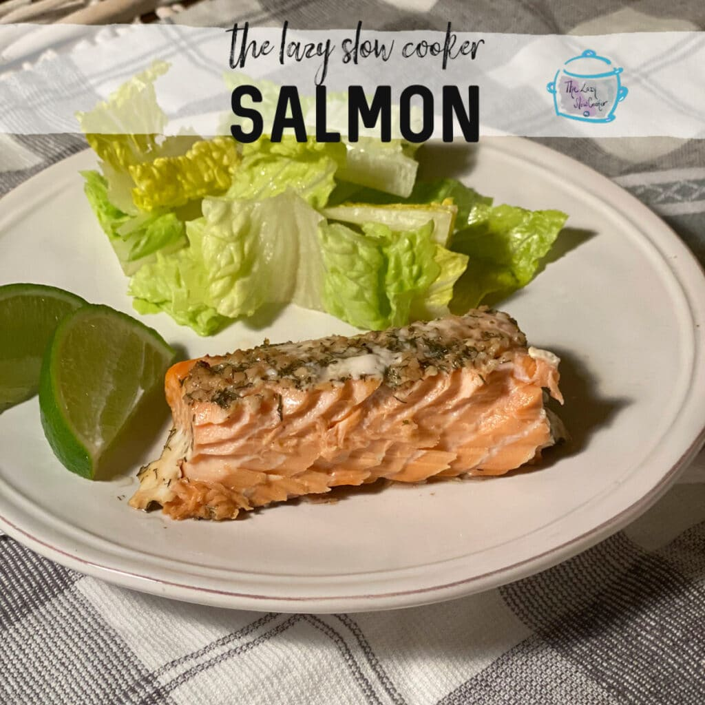 skinny slow cooker recipe  featuring with a piece of cooked salmon, lettuce and lime wedges