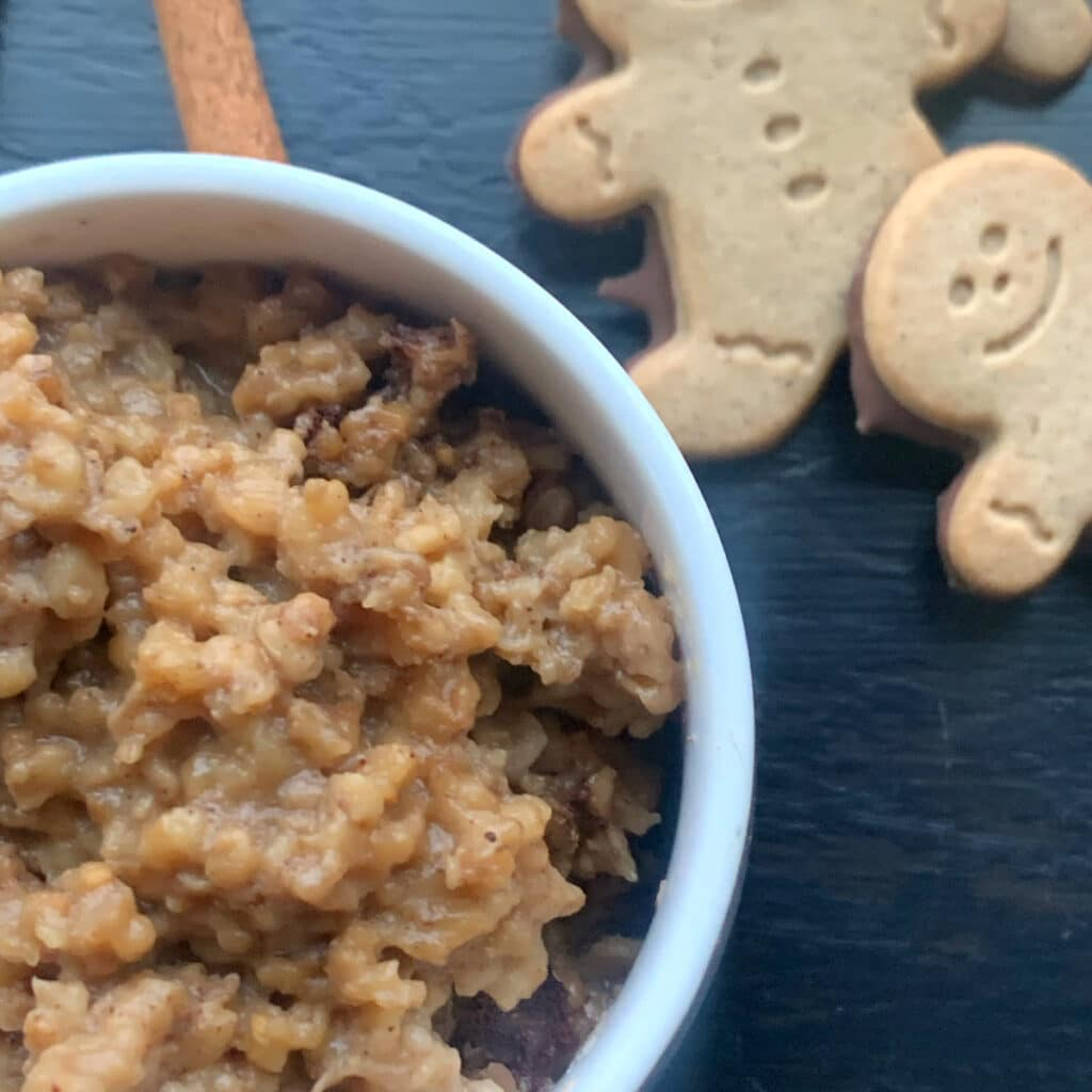 Oatmeal close up with gingerbread men cookie in the background
