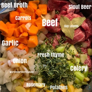 Raw ingredients for beef and beer stew in crockpot with labels prior to liquid being added