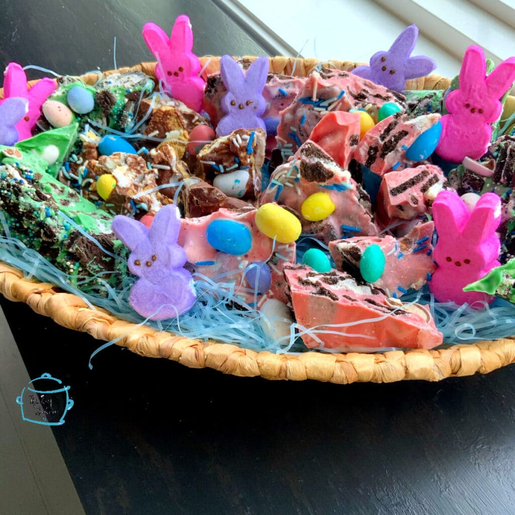 colorful bark and marshmallow bunnies in a basket decorated for Eater