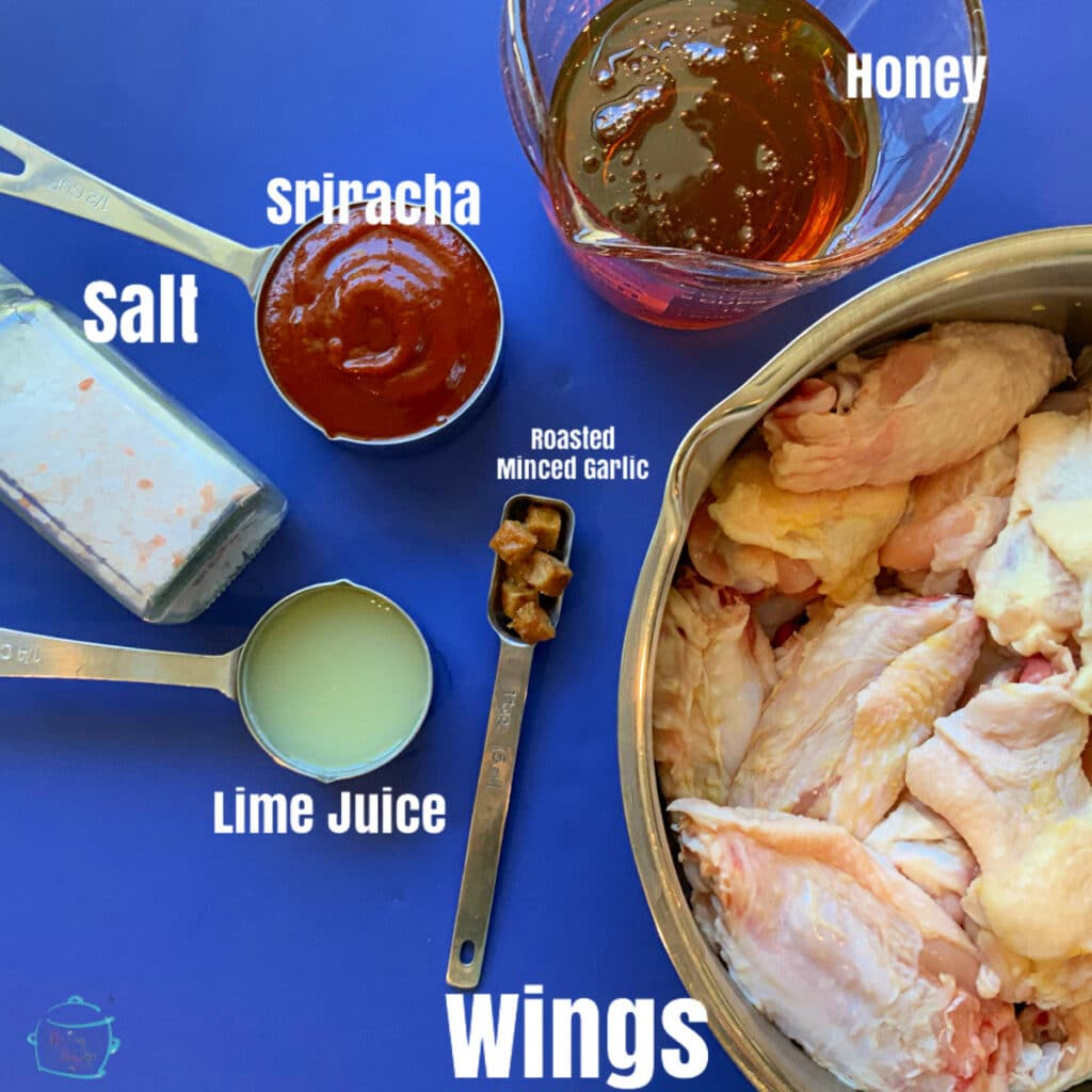 all hot honey wing ingredients with written labels on a blue background