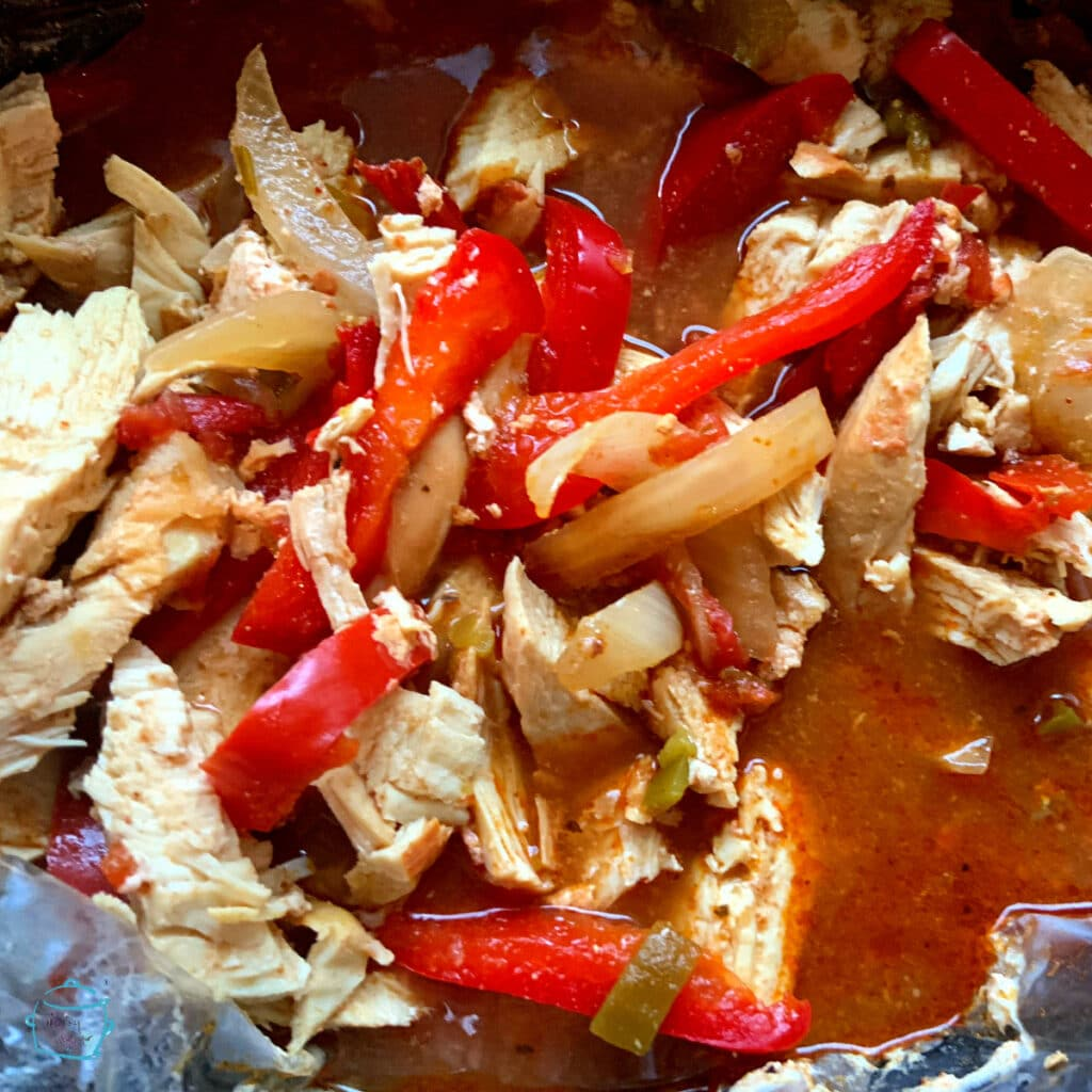All fajita ingredients in slow cooker right after cooking