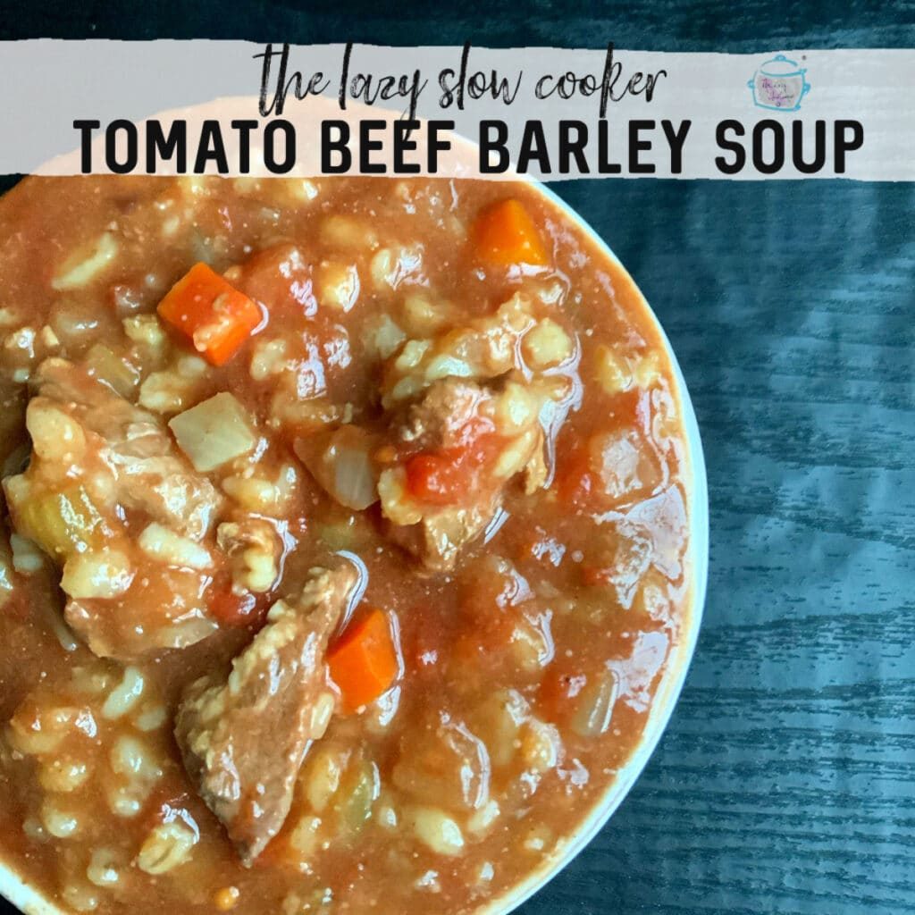 a bowl of thick, rich looking tomato beef barley soup