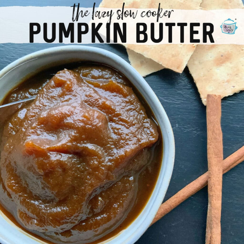 a bowl filled with pumpkin butter with some cinnamon sticks off to the side