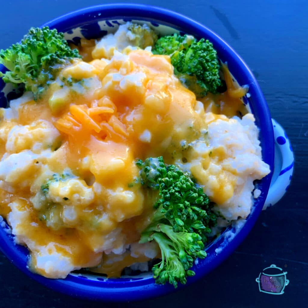 finished dish in a round blue bowl with cheese melted on top