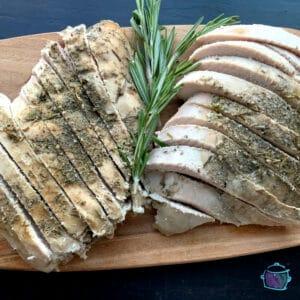 Finished sliced turkey breast on serving board