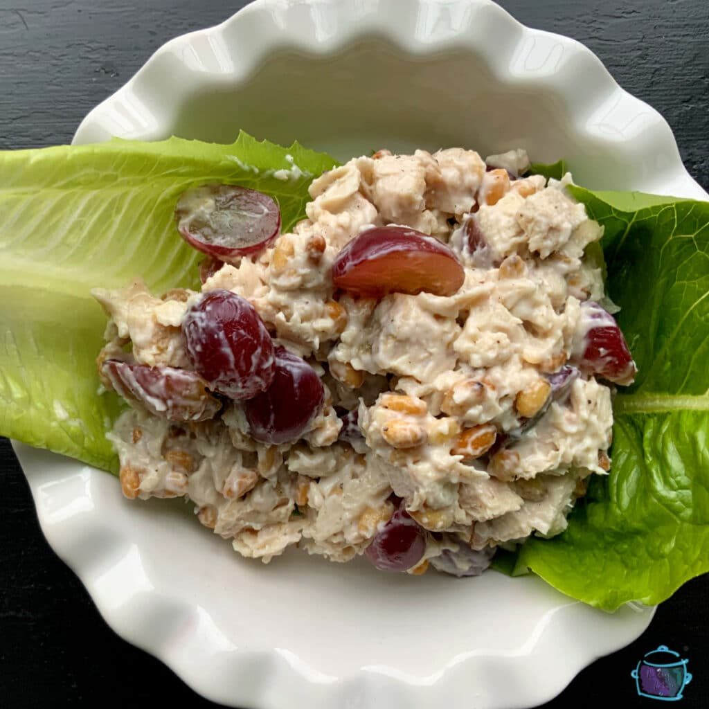 Turkey pine nut and grape salad with leftover crockpot turkey in a round white bowl
